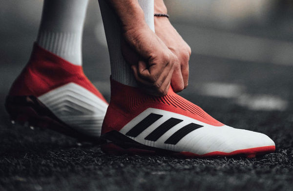 Adidas vede la frenata, ma alza stime utili 2018